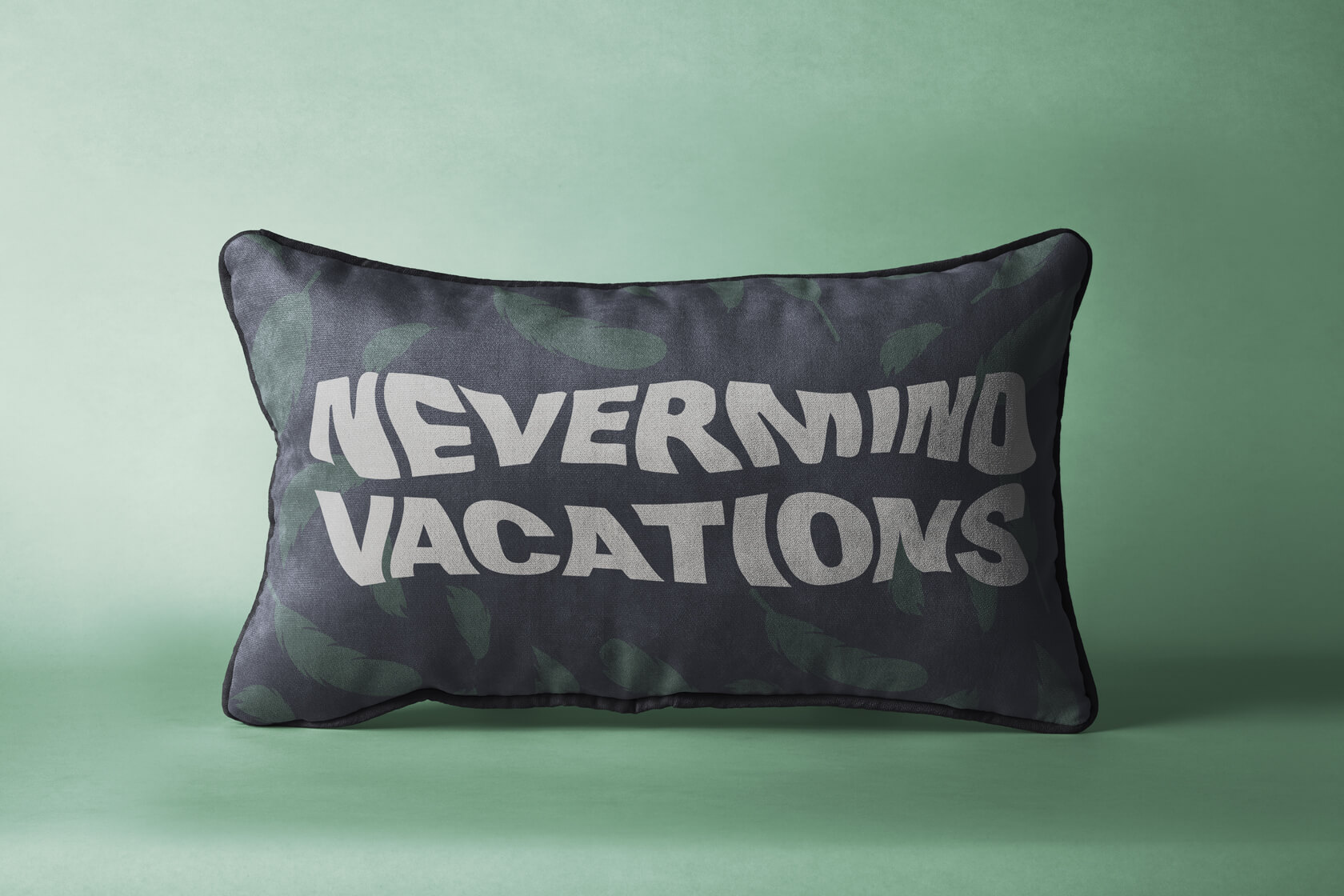Nevermind Vacations pillow logo